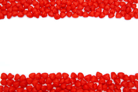 scattered in heart shaped: Valentines Day cinnamon hearts double edge border over white