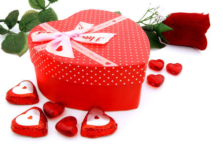 Heart-shaped Valentines Day gift box with rose and gems photo
