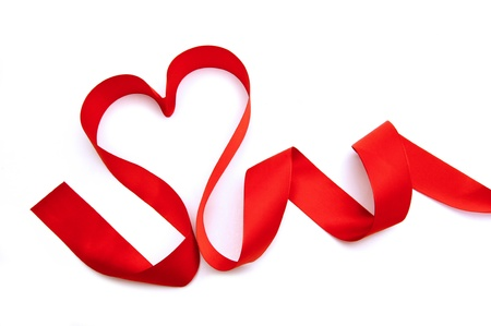 Vibrant trailing heart-shaped ribbon over a white background photo