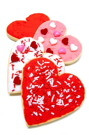 Group of colorful heart-shaped Valentines Day cookies with icing over white Stock Photo - 11980354