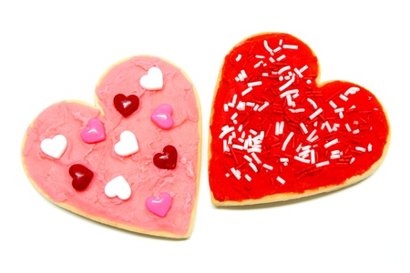 A couple of colorful heart-shaped Valentines Day cookies over white Stock Photo - 11980357