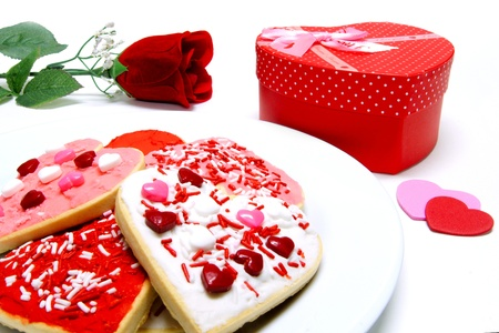 Colorful Valentines Day cookies on a plate with gift box and rose photo