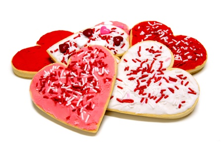 Pile of heart-shaped Valentines Day cookies over white