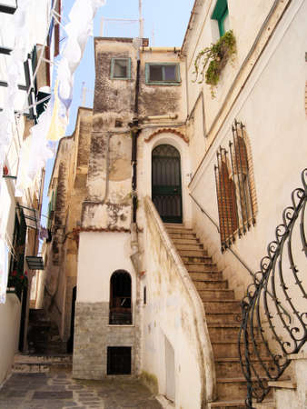 mediterranean house: Narrow ancient lane in the south of Italy Stock Photo