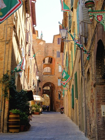 Narrow medieval street in Siena, Italy