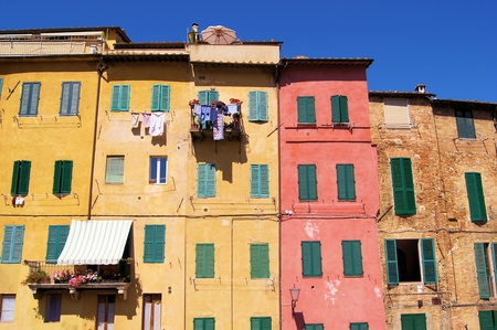 Colorful medieval houses of Siena, Italy  photo