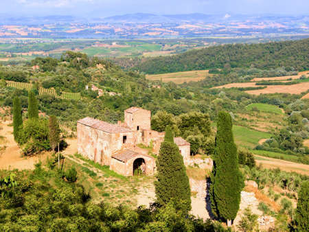 valdorcia: Old stone house amongst the vineyards and fields of Tuscany