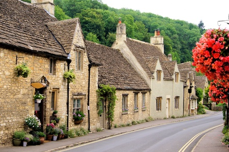 and heritage: Picturesque street in the Cotswold village of Castle Combe, England