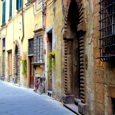 Old medieval street in Tuscany, Italy photo