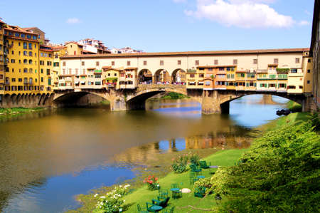 View of the famous Ponte Vecchio over the Arno River, Florence, Italy photo