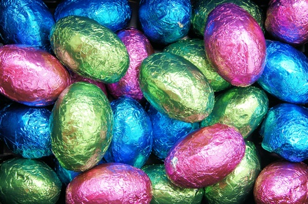 shiny background: Easter background of colorful, shiny candy eggs