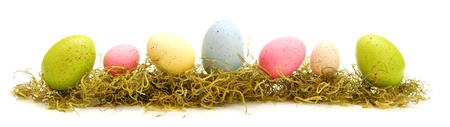 Long Easter border of colorful eggs over white