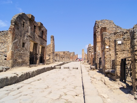 Ancient Pompeii road among the ruins photo