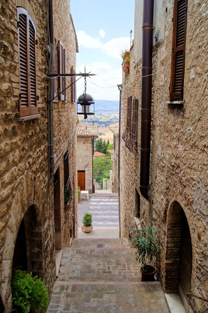 Medieval stepped street in the Italian hill town of Assisi photo