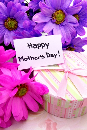 Mothers Day gifts - vibrant flowers and gift box close up