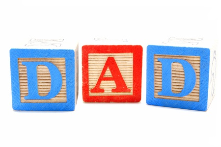 Childs wooden blocks with letters spelling DAD