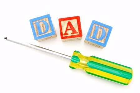 Fathers Day - Childs wooden blocks with letters spelling DAD with screwdriver photo
