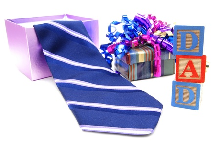 colourful tie: Fathers Day gift boxes and tie with DAD block toys Stock Photo