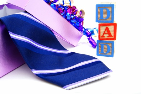 stereotype: Fathers Day gift box and tie with DAD toy blocks