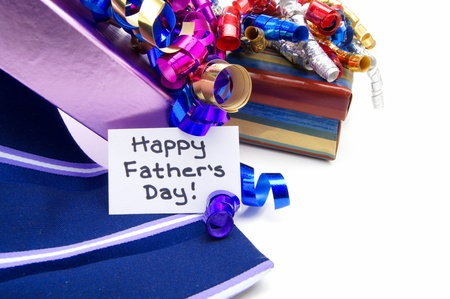 Happy Fathers Day tag with gift boxes and tie close up photo