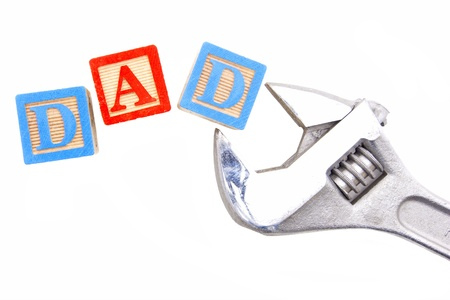 spelling: Fathers Day - Wooden blocks spelling DAD with wrench