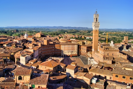 Aerial view over the medieval city of Siena, Italy including Il Campo