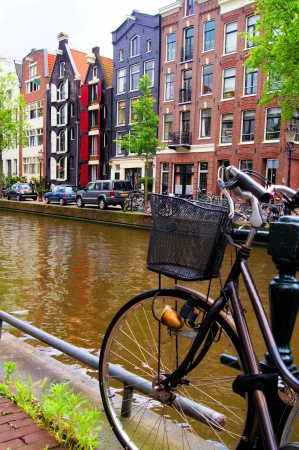 canal house: Bicycle along the canals of Amsterdam, The Netherlands Stock Photo