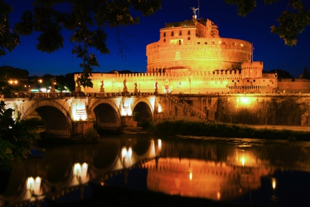 angelo: Rome landmark Castel Sant Angelo at night with reflections in the Tiber River, Italy