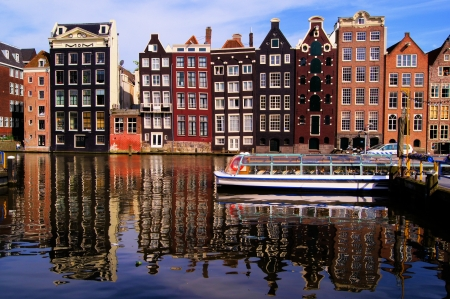 Traditional houses of Amsterdam with reflections in the canal, Netherlands