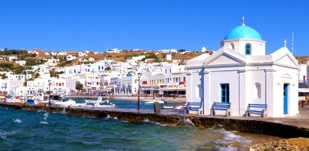 mykonos: Panoramic view of Mykonos harbor with traditional blue dome church, Greece Stock Photo