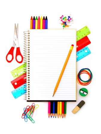 Blank notebook with pencil and colorful school supplies surrounding photo