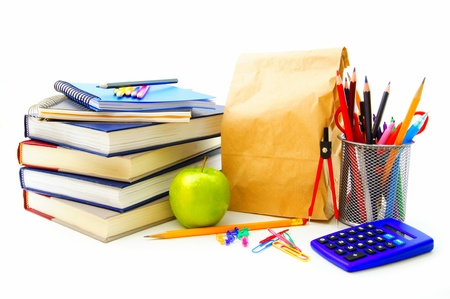school notebook: Group of various school supplies and items over a white background
