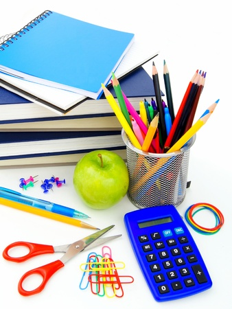 school supplies: Group of various school supplies and items over a white background