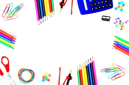 Colorful frame of school supplies over a white background photo