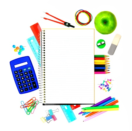 Blank opened notebook with colorful school supplies surrounding