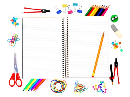 Blank opened notebook with pencil and colorful school supplies surrounding photo