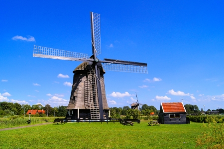 Traditional Dutch windmill under blue skies near Almaar, The Netherlands Stock Photo - 14615310
