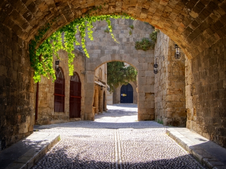 Medieval arched street in the old town of Rhodes, Greece photo