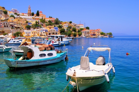 Colorful harbor district of the town of Symi, Greece photo
