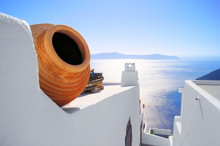 View out to sea over the white walls of Santorini, Greece photo