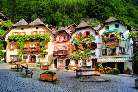 Colorful and picturesque village square in Hallstatt, Austria photo