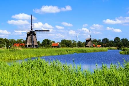 Traditional Dutch windmills along a canal near Alkmaar, Netherlands Stock Photo - 15012741