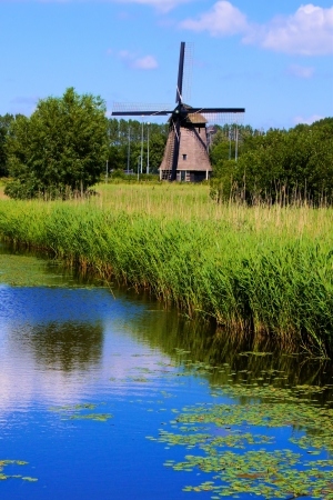 Traditional Dutch windmill along a canal near Alkmaar, Netherlands Stock Photo - 15012742