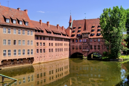 Ancient hospital from the Middle Ages along the river, Nuremberg, Germany photo