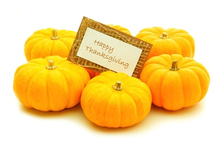 Group of pumpkins with Happy Thanksgiving card over white photo