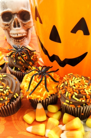 Halloween treats - cupcakes, candy and decor photo