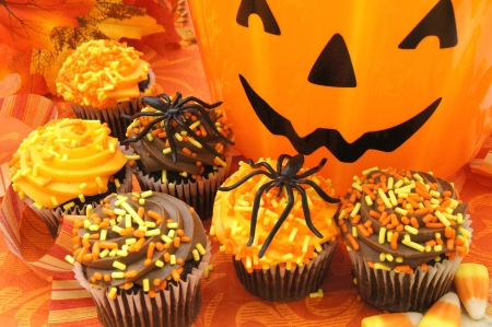 Happy Halloween - Colorful cupcakes with jack o lantern  photo