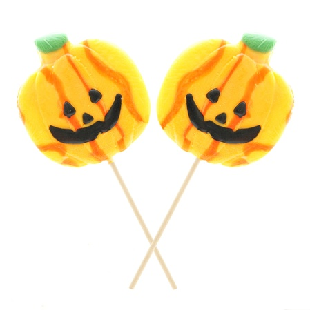 Two Halloween jack o lantern lollipops isolated on white photo