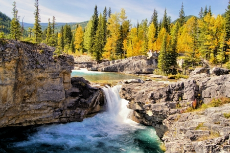 Waterfall in the Kananaskis region of the Canadian Rockies during autumn photo
