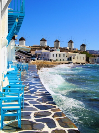 greece shoreline: View of the famous windmills of Mykonos town, Greece